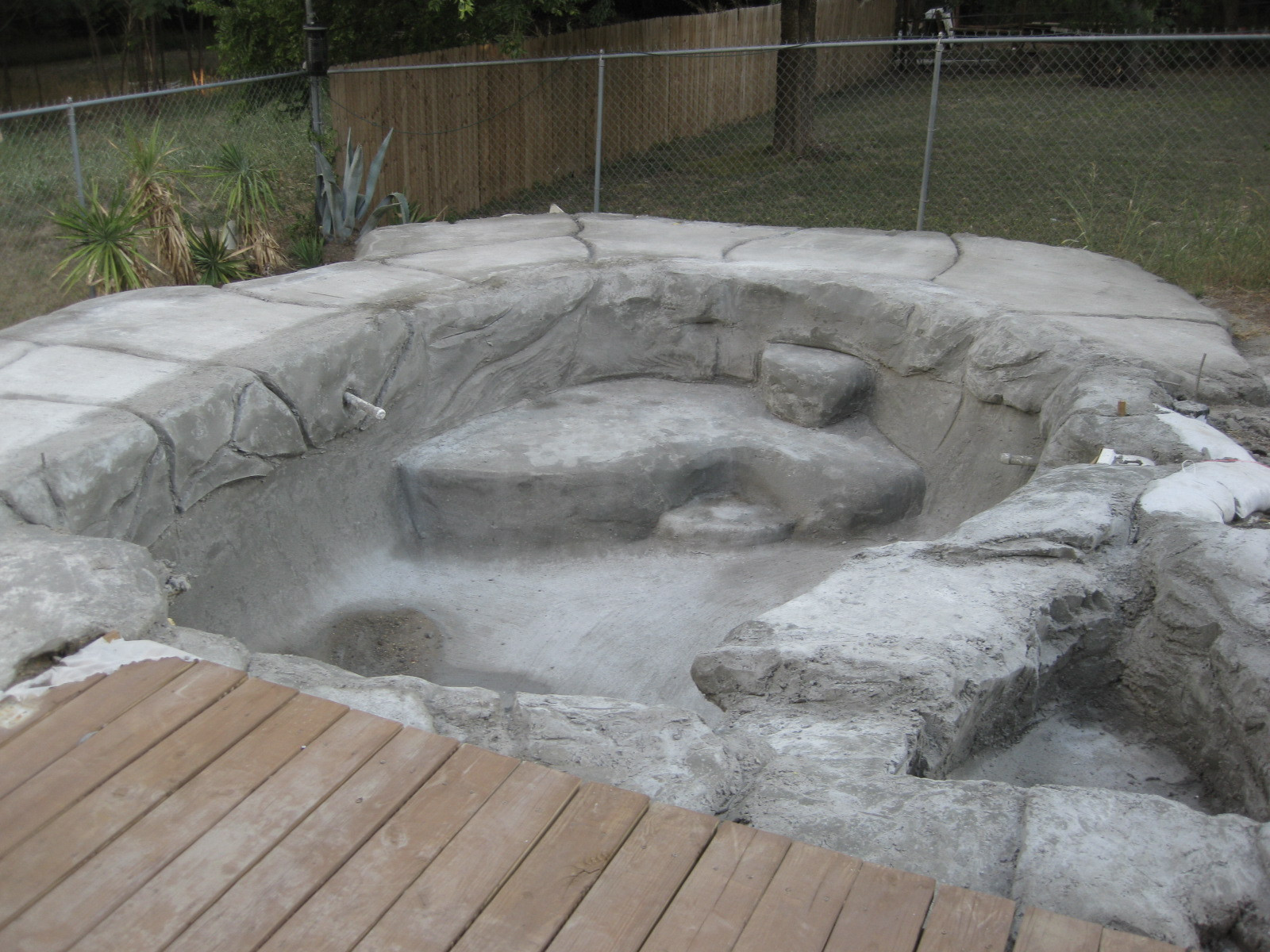 The week after shotcrete..Yes.. it takes a week for this stuff to dry.. and there's a certain recipe you must follow for keeping it moist in the August sun. My wife said that it looked like a pengin habitat at the zoo.. couldn't argue